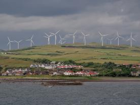The skyline of Ardrossan,  North Ayrshire, is dominated by an enormous wind farm. However, the general climate of acceptance is a positive one. (Photo: Vincent van Zeijst)